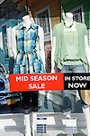 Mid season sale sign clothes shop window
