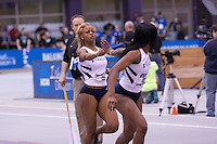 Yanique Haye hands off to Dereka Kelly in the 4x400.