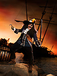 Pirate ashore with a treasure chest