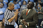 14 November 2012: Referee Daryl Humphrey (left) explains a call to Georgetown head coach Keith Brown (right). The University of North Carolina Tar Heels played the Georgetown University Hoyas at Carmichael Arena in Chapel Hill, North Carolina in an NCAA Division I Women's Basketball game, and a semifinal in the Preseason WNIT. UNC won the game 63-48.