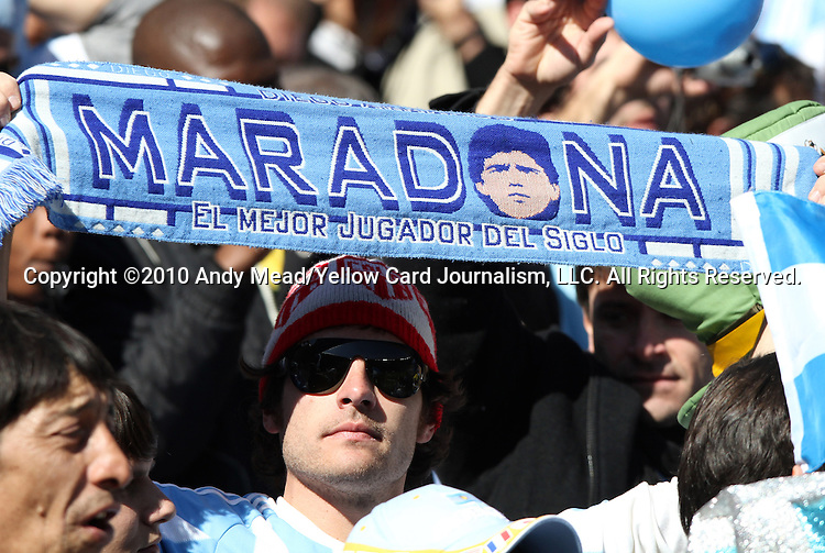 17 JUN 2010: An Argentina fan holds up a Maradona scarf. The Argentina National Team defeated the South Korea National Team 4-1 at Soccer City Stadium in Johannesburg, South Africa in a 2010 FIFA World Cup Group E match.