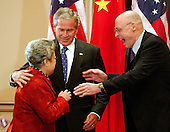 Washington, D.C. - May 24, 2007 -- United States Secretary of the Treasury Henry Paulson, right, greets Chinese Vice Premier Wu Yi, special envoy of Chinese President Hu Jintao, left, as United States President George W. Bush, center, looks on prior to the meeting of the United States - China Strategic Economic Dialogue at the White House in Washington, D.C. on Thursday, May 24, 2007.  The U.S. - China Strategic Economic Dialogue promotes economic cooperation and the growth of U.S. - China relations.United States President George W. Bush meets with the Chinese Delegation to the United States - China Strategic Economic Dialogue at the White House in Washington, D.C. on Thursday, May 24, 2007.  The U.S. - China Strategic Economic Dialogue promotes economic cooperation and the growth of U.S. - China relations..Credit: Ron Sachs / CNP
