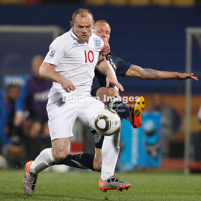 RUSTENBURG, SOUTH AFRICA - JUNE 12:  Wayne Rooney of England (10) attacks against the United States as Jay DeMerit (r) defends during a  2010 FIFA World Cup soccer match June 12, 2010 in Rustenburg, South Africa.  NO mobile use.  Editorial ONLY.  (Photograph by Jonathan P. Larsen)