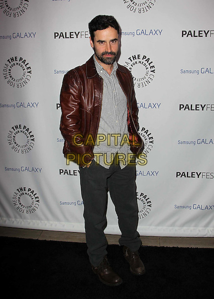 Jesse Bradford.PaleyFest Icon Award 2013 Held At The Paley Center for Media, Beverly Hills, California, USA..February 27th, 2013.full length grey gray shirt brown leather jacket beard facial hair jeans denim hand sin pockets .CAP/ADM/KB.©Kevan Brooks/AdMedia/Capital Pictures.
