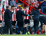 Caolan Lavery of Sheffield Utd goes off injured during the Championship match at Bramall Lane, Sheffield. Picture date 26th August 2017. Picture credit should read: Simon Bellis/Sportimage