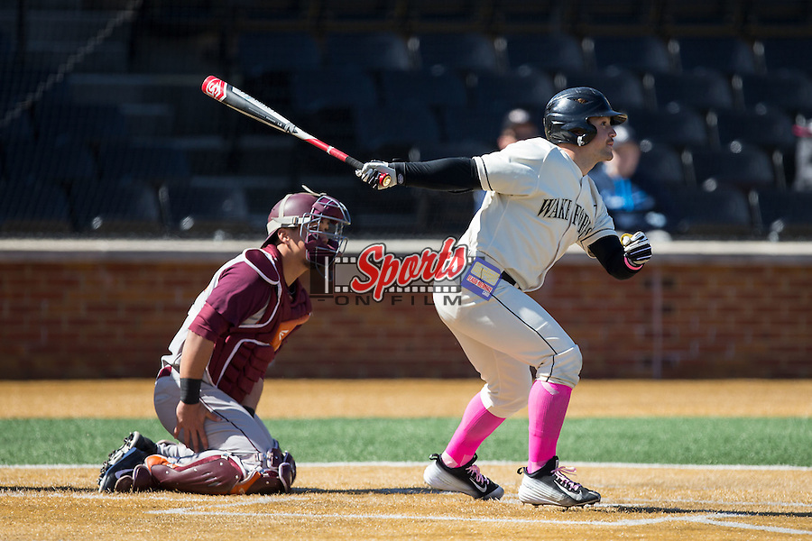 Nate Mondou (10) of the Wake Forest Demon Deacons follows through on his swing against the Virginia Tech Hokies at Wake Forest Baseball Park on March 7, 2015 in Winston-Salem, North Carolina.  The Hokies defeated the Demon Deacons 12-7 in game one of a double-header.   (Brian Westerholt/Sports On Film)