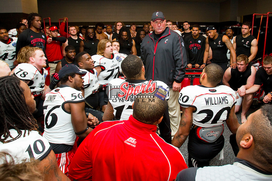 Cincinnati Bearcats interim head coach Steve Stripling addresses the team following their win over the Duke Blue Devils in the 2012 Belk Bowl at Bank of America Stadium on December 27, 2012 in Charlotte, North Carolina.  The Bearcats defeated the Blue Devils 48-34.  (Brian Westerholt/Sports On Film)