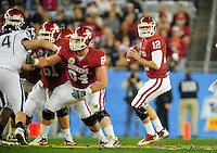 Jan. 1, 2011; Glendale, AZ, USA; Oklahoma Sooners quarterback (12) Landry Jones drops back to pass in the second quarter against the Connecticut Huskies in the 2011 Fiesta Bowl at University of Phoenix Stadium. Mandatory Credit: Mark J. Rebilas-.