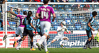 Goalkeeper Ryan Allsop (Loanee from Bournemouth) of Wycombe Wanderers saves from John Akinde of Barnet during the Sky Bet League 2 match between Wycombe Wanderers and Barnet at Adams Park, High Wycombe, England on 16 April 2016. Photo by Andy Rowland.