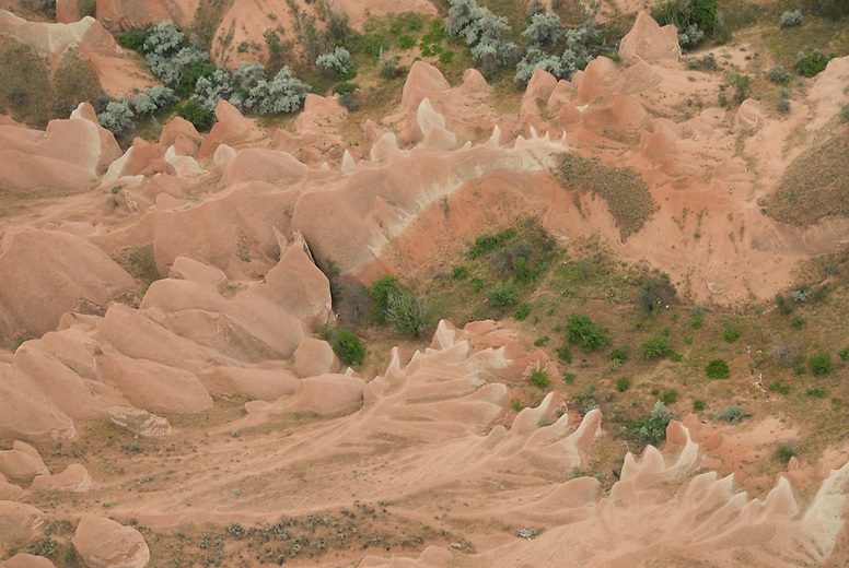 The incredibly unique landscape of Cappadocia, in central Turkey. Created 60 million years ago by three neighboring volcanoes, the compacted ash created rock, called tufa, that has been slowly eroded by wind, rain, snow and rivers. The easily carvable rock was home to over 3000 cave dwellings, churches and monasteries.