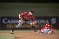 AZL Diamondbacks shortstop Alex King (9) prepares to apply the tag to Daniel Ozoria (23) on a stolen base attempt during an Arizona League game against the AZL Angels at Tempe Diablo Stadium on June 27, 2018 in Tempe, Arizona. The AZL Angels defeated the AZL Diamondbacks 5-3. (Zachary Lucy/Four Seam Images)