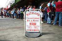 West Ham United fans queue to Nathans - traditional Pie and Mash shop   before  the Barclays Premier League match between West Ham United and Swansea City  played at Boleyn Ground , London on 7th May 2016