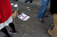 Discarded K cards litter the ground outside Fenway Park during the 2011 season opener in Boston, Massachusetts, USA.