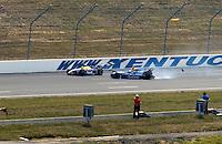 IRL Belterra Casino 300, Kentucky Speedway, Sparta, Kentucky, USA 11 August,2002  Airton Dare (L) and Tomas Scheckter (R) crash along the back straight..Copyright©F.Peirce Williams 2002  .