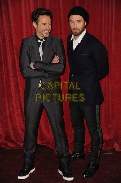 Robert Downey Jr. & Jude Law.'Sherlock Holmes: A Game Of Shadows' European Premiere at Empire Leicester Square cinema, London, England..8th December 2011.full length grey gray suit blue jacket stripe trousers hat beanie beard facial hair arms crossed.CAP/CAS.©Bob Cass/Capital Pictures.