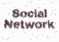 """Overhead view of people forming words """"social network"""""""