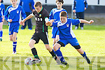 Kingdom Boys Mike Kelliher gets passed Corbally's Oliver Plunkett in the .U13 national cup at Cahermoneen, Tralee on Saturday.