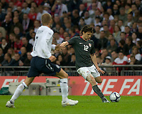 Heath Pearce (12) centers the ball by David Beckham. The United States Men's National Team lost to England 2-0 in an international friendly at Wembley Stadium, London, England. May 28, 2008.