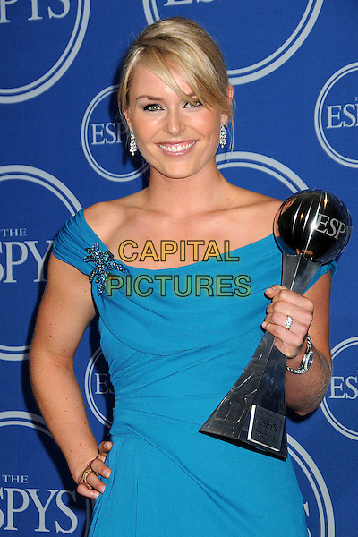 LINDSEY VONN.18th Annual ESPY Awards - Press Room held at Nokia Theatre L.A. Live, Los Angeles, California, USA, .14th July 2010..espys half length blue teal dress award winner trophy brooch hand on hip.CAP/ADM/BP.©Byron Purvis/AdMedia/Capital Pictures.