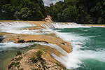 The Agua Azul Waterfalls are a series of cascades on the Xanil River in Chiapas, Mexico.  The river is a turquoise color because of the high mineral content in the water.  A slow camera shutter speed smooths out the motion of the water, giving it a silky look.