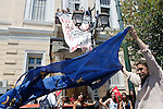 Protesters of the far-left party ANTARSYA occupied the offices of European union  in the center of Athens and burned European Union flag.
