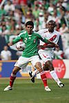 June 08 2008:  Johnny Magallon (CD Guadalajara) (2) of Mexico shields the ball from Miguel Villalta (Sporting Cristal) (23) of Peru.  During the third and final match of Mexico's 2008 USA Tour in preparation for qualification for FIFA's 2010 World Cup, the national soccer team of Mexico defeated Peru 4-0 at Soldier Field, in Chicago, IL.