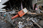 Photo shows a Japan Post Service Co., Ltd. post box lying among the rubble of Kamishi city, Iwate Prefecture, Japan on 04 April 2011. Some 500 mail boxes were washed away by the tsunamis that swept through Japan's northeast on March 11..Photographer: Robert Gilhooly