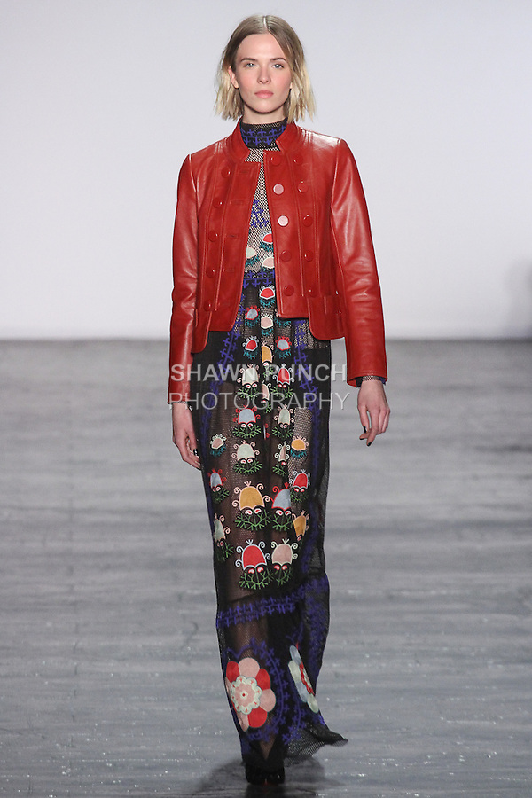 """Model Vikoria walks runway in a mesh maxi dress with embroidered parasol flower applique in black with mandarin collar leather jacket in sangria, from the Vivienne Tam Fall Winter 2016 """"Cultural Dreamland The New Silk Road"""" collection, presented at NYFW: The Shows Fall 2016, during New York Fashion Week Fall 2016."""