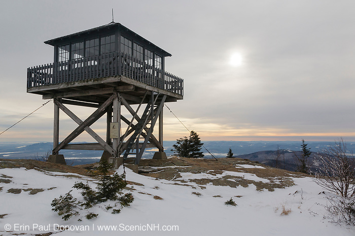 Kearsarge North (Pequawket) Tower on the summit of Kearsarge North in the White Mountains, New Hampshire USA on a cloudy day. This fire tower is listed on the National Historic Lookout Register, and operated from 1901-1968.