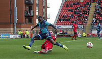 Nicky Hunt of Leyton Orient tackles Myles Weston of Wycombe Wanderers during the Sky Bet League 2 match between Leyton Orient and Wycombe Wanderers at the Matchroom Stadium, London, England on 1 April 2017. Photo by Andy Rowland.
