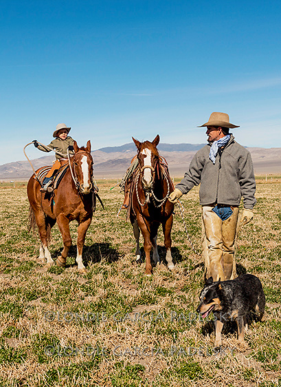 Cowboys Nick Dowers and son Crue, riding the ranch in Dyer, Nevada