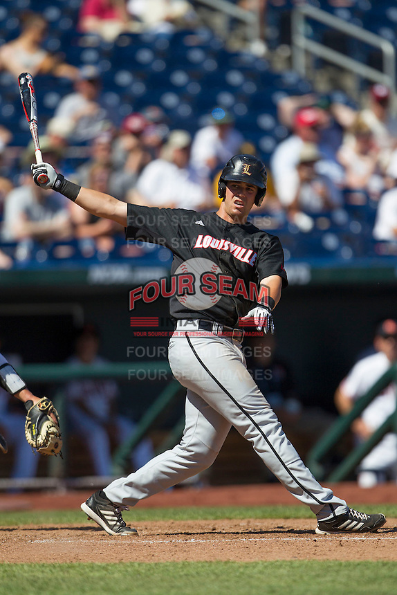 Louisville first baseman Zak Wasserman (26) follows through on his swing against the Oregon State Beavers during Game 5 of the 2013 Men's College World Series on June 17, 2013 at TD Ameritrade Park in Omaha, Nebraska. The Beavers defeated Cardinals 11-4, eliminating Louisville from the tournament. (Andrew Woolley/Four Seam Images)