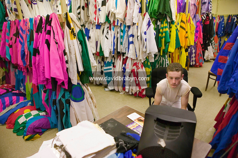 27 May 2006 - ELMONT, NY - 22 year-old French apprentice jockey Julien Leparoux watches a race replay on television in the room where the riders' colors are stored at Belmont Park hippodrome in Elmont, outside New York City, USA, 27 May 2006.