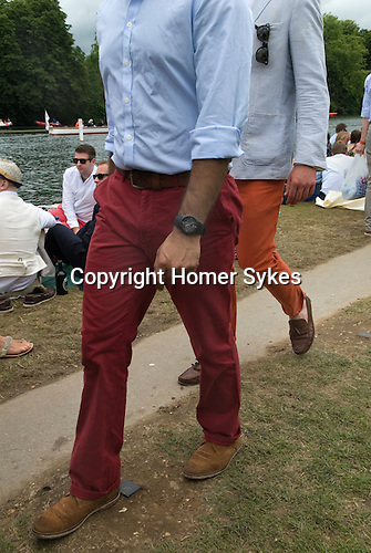 Henley on Thames UK. Man wearing red trousers.