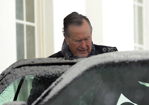 Former United States President George H.W. Bush departs the West Wing of the White House after he and and his son former Florida Governor Jeb Bush met with U.S. President Barack Obama in Washington, D.C. on Saturday, January 30, 2010. .Credit: Alexis C. Glenn / Pool via CNP