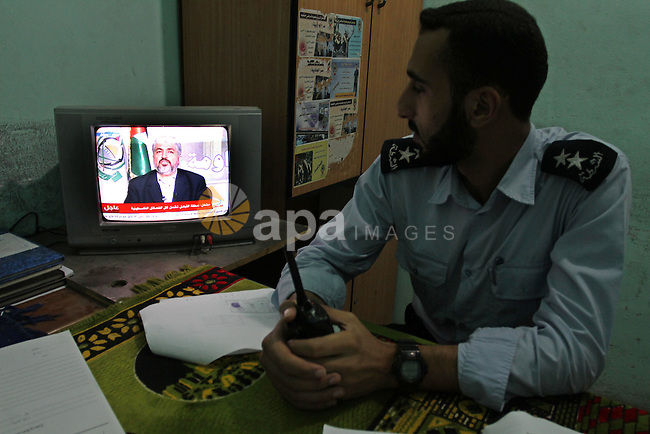 Palestinian Hamas security forces watch a television broadcasting the speech of Hamas leader Khaled Meshaal celebrating a deal that will see Palestinian detainees freed in exchange for Israeli soldier Gilad Shalit on October 11, 2011, in Gaza city. Shalit was captured in 2006 by Hamas-allied militants in the Gaza Strip. Photo by Mohammed Asad