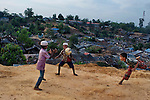 Children play with a soccer ball at a camp for Rohingya people in Ukhiya, near Cox's Bazar, a southern coastal district about, 296 kilometers (183 miles) south of Dhaka, Bangladesh.