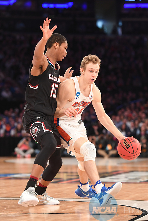 NEW YORK, NY - MARCH 26:  Canyon Barry #24 of the Florida Gators is guarded by PJ Dozier #15 of the South Carolina Gamecocks during the 2017 NCAA Men's Basketball Tournament held at Madison Square Garden on March 26, 2017 in New York City. (Photo by Justin Tafoya/NCAA Photos via Getty Images)<br /> ***Local Caption*** Canyon Barry
