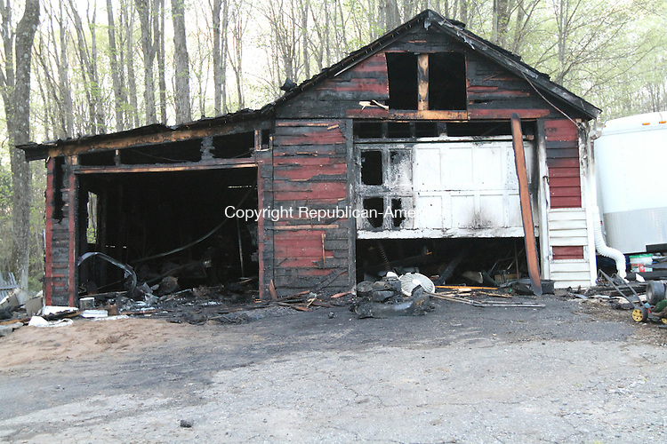 HARWINTON, CT - 5 May, 2011 - 050511MO01 - Harwinton volunteers knocked down a fire in this garage owned by Nick Ashborn, who was working on a lawn mower when a stray spark ignited gasoline Thursday evening. Jim Moore Republican-American.