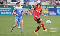 Portland, Oregon - Wednesday June 22, 2016: Portland Thorns FC midfielder Tobin Heath (17) controls the ball in front of Chicago Red Stars defender Arin Gilliland (3) during a regular season National Women's Soccer League (NWSL) match at Providence Park.