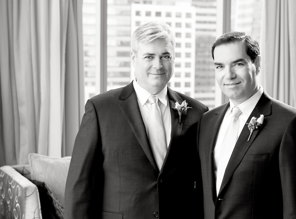 A black & white portrait of the two grooms.
