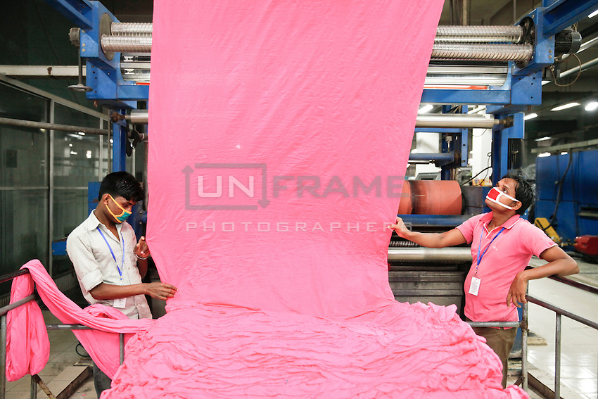 Bangladeshi workers work at a dyeing section of a garments factory in gazipur, near DHaka, Bnagladesh