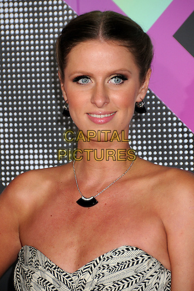 NICKY HILTON.The T-Mobile Sidekick 4G Launch Party held at a private lot in Beverly Hills, California, USA..April 20th 2011.headshot portrait necklace hair up beauty make-up tanned strapless earrings black print .CAP/ADM/BP.©Byron Purvis/AdMedia/Capital Pictures.