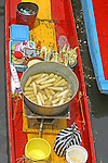 Vendor's barge displays corn on the cob, condiments and refreshments for sale to hungry visitors passing by on tourist barges at Xochimilco (a Mexico City suburb with a community accessible by canals only) Mexico state, Mexico