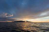 View of Maui at sunset from a boat.