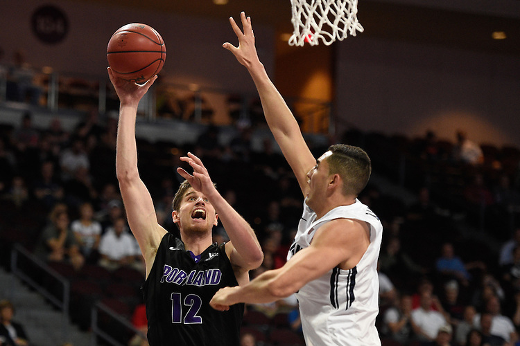 March 9, 2015; Las Vegas, NV, USA; Portland Pilots center Thomas van der Mars (12) shoots the basketball against Brigham Young Cougars center Corbin Kaufusi (44) during the second half of the WCC Basketball Championships at Orleans Arena.