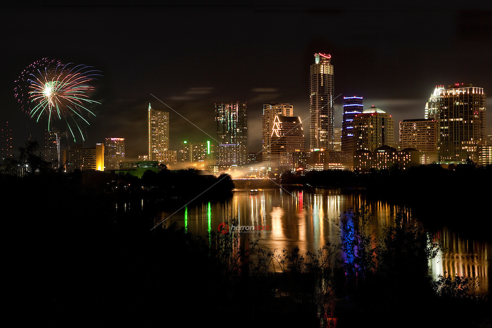 Austinites Celebrate a New Year's Eve Fireworks Display on Ladybird Lake in Austin, Texas