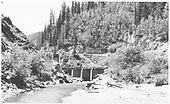 A side view of RGS Bridge 64-A in Burns Canyon after abandonment.<br /> RGS  Burns Canyon, CO  Taken by Maxwell, John W. - 8/19/1958