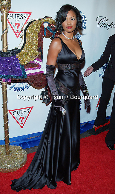 Garcelle Beauvais arriving at the Carousel of Hope which support the Barbara Davis Center for Childhood Diabetesat the Beverly Hilton in Los Angeles. October 15, 2002.