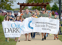NWA Democrat-Gazette/BEN GOFF @NWABENGOFF<br /> Walkers make their way through Orchards Park in Bentonville on Sunday Sept. 20, 2015 during the second annual Out of the Darkness Community Walk of Northwest Arkansas. The fundraiser more than doubled in size this year, according to organizer Tyler West with the Arkansas Suicide Prevention Council, with 633 walkers raising $22,063 to help support suicide awareness and prevention efforts. Many of the walkers were family and friends of someone who took their own life.